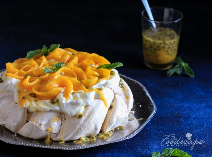 Mango Passion Fruit Pavlova - crispy pavlova crust, marshmallow center, topped with whipped cream, mangoes and passion fruit. Mango Pavlova Recipe. Mango Desserts Recipes