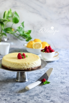 A lush, creamy Baked Lemon Cheesecake topped with a tangy and delicious Raspberry Sauce. A beautiful Spring/Summer Dessert, Lemon Dessert recipe, that is sure to be among your favourites! Cheesecake Recipe. Food Photography