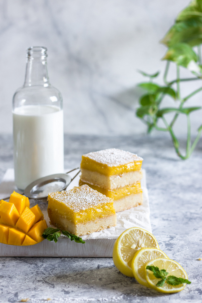 Mango Lemon Bars - a wonderful twist on the old fashioned classic Lemon Bars oozes with sunny golden mango goodness, has a sweet and tangy Mango Lemon filling, with a delightful Coconut Cookie base - buttery, crumbly and oh so delicious! Mango Lemon Bars Recipe. Lemon Bars Recipe. Easy Lemon Bars Recipe. Lemon Desserts. Lemon Tart Recipe. Mango Lemon Curd Recipe.
