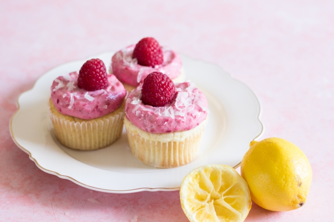Lemon Coconut Raspberry Cupcakes Recipe. Coconut Cupcakes Recipe. Lemon Cupcakes dotted with Coconut flakes and Coconut milk topped with the best ever Raspberry Cream Cheese Frosting. Lemon Cake Recipe. Raspberry Cupcakes Recipe. Pink Raspberry Cupcakes Recipe. Cupcakes Recipe. Cream Cheese Frosting Recipe. Cake Recipe. Food Photography & Styling.