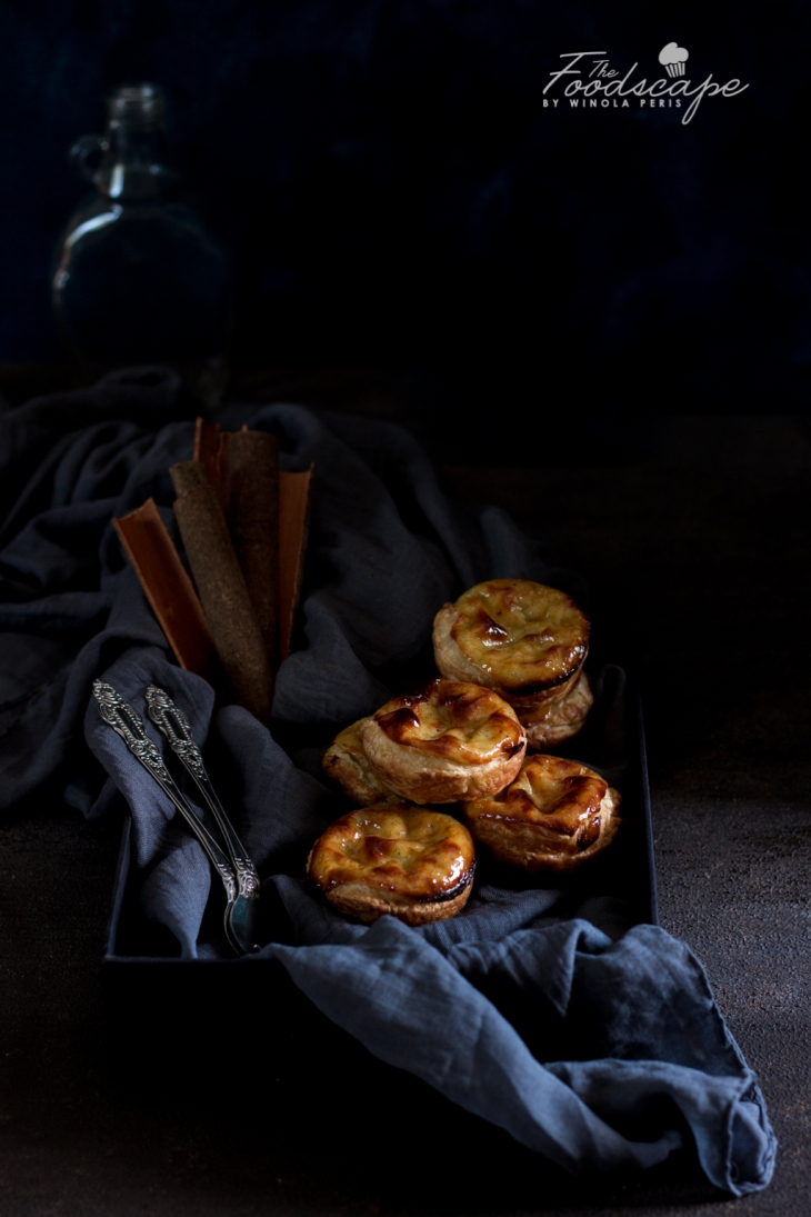 Easy homemade Portuguese Custard Tarts Recipe. Pasteis De Nata Recipe. Homemade Pastel de Nata Recipe. Portuguese Egg Tarts Recipe. Custard Tarts Recipe. Egg Custard Tarts Recipe. Egg Tarts Recipe. Puff Pastry Tarts Recipe. Dessert Recipes. Food Photography. #dessert #recipe #foodphotography #dessertrecipes #portugal