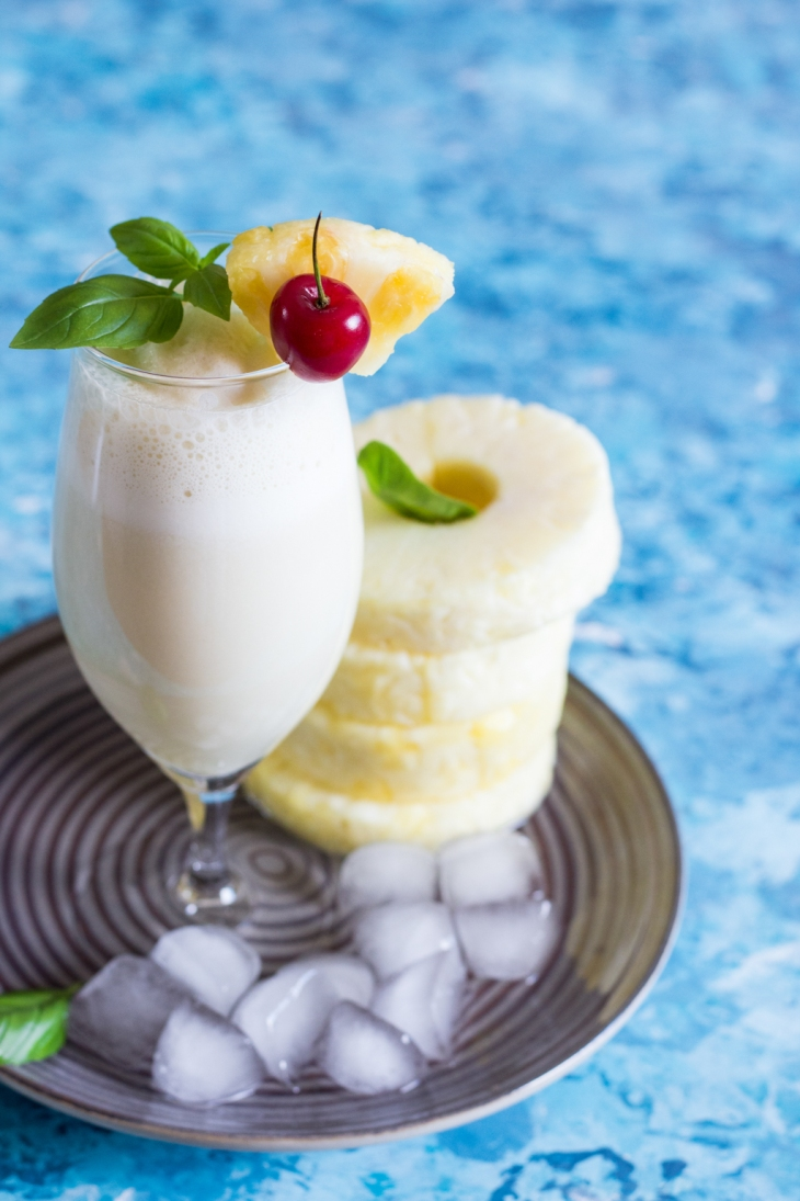 Virgin Pina Colada Recipe. Kid-friendly drinks recipe. Non Alcoholic Pina Colada with Coconut Milk, Pineapple Juice. Pina Colada Recipe with Coconut Rum. Coconut Cream. Cocktail Recipe. Mocktail Recipe. Food Photography. Drinks Photography